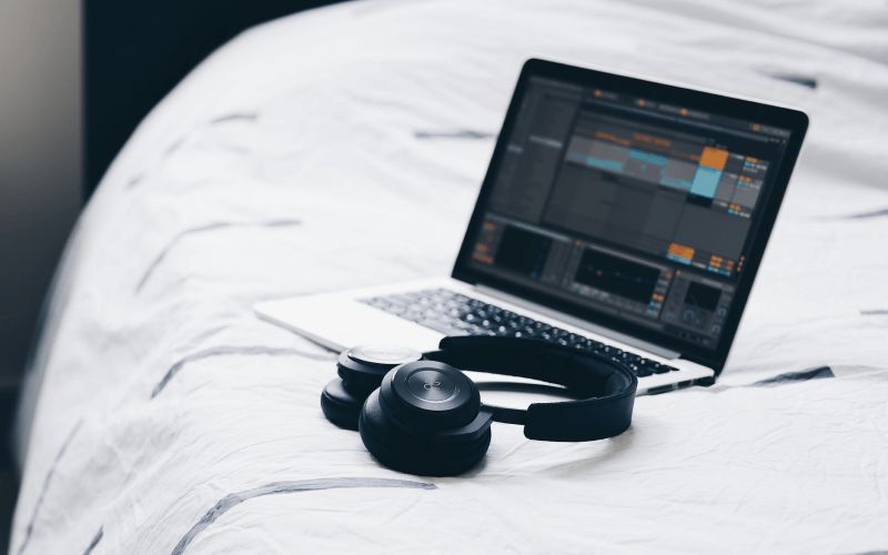 ableton-on-laptop-on-bed-with-headphones